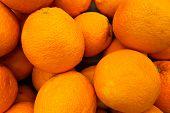 Oranges Background. Fresh Oranges Variety Grown In The Shop. Oranges Suitable For Juice, Strudel, Or poster