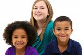 image of babysitter  - Multiracial Family Portrait Children Only Over White - JPG