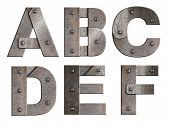 Old grunge metal alphabet letters isolated on white. From A to F.