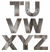 Old grunge metal alphabet letters isolated on white. From T to Z.