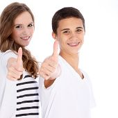Happy Teenagers Giving A Thumbs Up