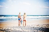 Two surfer girls