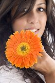 Close Up Of Beautiful Model With Orange Gerbera