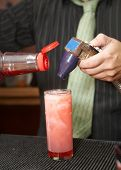 foto of mixing faucet  - Bartender pouring mixed drink at cocktail hour - JPG