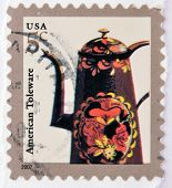 A stamp printed in USA shows image of a Toleware coffeepot