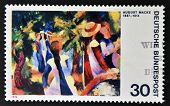 GERMANY - CIRCA 1974: a stamp printed in Germany shows Girls under Trees Painting by August Macke ci