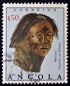 ANGOLA - CIRCA 1976: A stamp printed in Angola shows leather mask with painted decoration circa 1976
