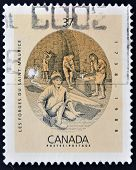 A stamp printed in Canada shows the forges of St. Maurice