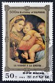 DPR KOREA - CIRCA 1983: A stamp printed in North Korea shows la Vierge a la chaise by Raphael on the