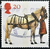 UNITED KINGDOM - CIRCA 1997: A stamp printed in Great Britain shows Carriage Horse and Coachman circ