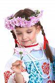 Beautiful girl in slavic costume and garland