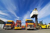 stock photo of lift truck  - Lift truck loading shipping containers onto trucks - JPG