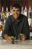 Male bartender serving drinks