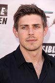 LOS ANGELES - AUG 10:  Chris Lowell at the Invisible Children Fourth Estate's Founders Party at the