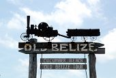 Old Belize Museum and Cucumber Beach sign in Belize City