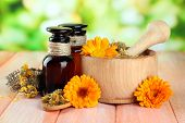 image of mixture  - Medicine bottles and calendula flowers on wooden table - JPG