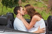 picture of straddling  - Beautiful couple kissing in back seat of a convertible - JPG