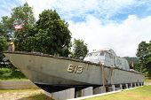 PHANG-NGA, THAILAND - JUNE 9 : Tsunami Police Boat 813 (Buretpadungkit) at Tsunami Memorial Park on June 9, 2013. The boat was swept inland almost 2 Km. in December 2004, to where it sits today.