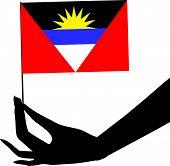 Bandera de antigua y Barbuda en la mano