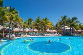 PLAYA DEL CARMEN, MEXICO - JULY 20: Scenery of luxury swimming pool at RIU Yucatan Hotel  in Playa d
