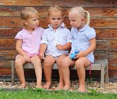 stock photo of bench  - Funny siblings on a rural bench - JPG
