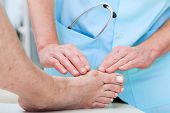 foto of medical condition  - Orthopedist at work checking patient - JPG