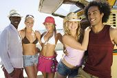 stock photo of campervan  - Portrait of a multiethnic group of young people by campervan - JPG
