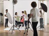 Group of multiethnic young people in studio during photo session