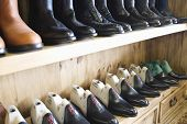 Closeup of footwear in a row at traditional shoemaker workshop