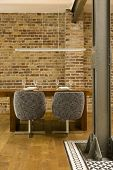 pic of koln  - View of spacious dining room with brick wall and wooden flooring in modern house - JPG