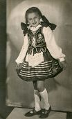 LODZ, POLAND, CIRCA FIFTIES - vintage photo of little girl in folk costume, Lodz, Poland, circa fift