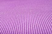 Close up shot of a purple yoga mat