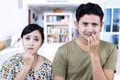 Afraid Couple Biting Nails At Home