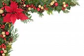 Christmas and winter floral border with poinsettia flower, decorations, natural holly, mistletoe and