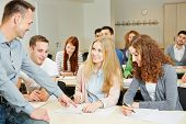 Teacher helping students in university seminar class