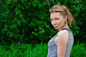 Capricious Woman Against Green Summer Background