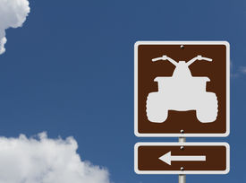 image of four-wheelers  - An American road sign with a symbol of an ATV and sky Places to ride ATV - JPG