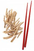 Ginseng herb with red chopsticks over white background.
