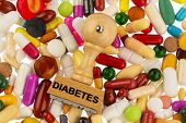 pic of diabetes mellitus  - stamp on colorful tablets - JPG