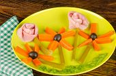 stock photo of olive shaped  - Cold salad with ham in the shape of flowers a healthy kid meal