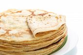 picture of pancake flip  - many thin pancakes on a white background - JPG