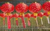 red lanterns with chinese letters printed. It brings good luck and peace to prayer.Guessing Lantern Riddles