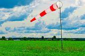 Striped Windsock In A Green Field