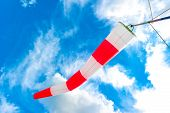 Blue Sky And Striped Windsock