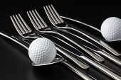 Forks,spoons And Knifes And Golf Balls
