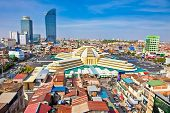 PHNOM PENH,CAMBODIA-DEC 3, 2013:Psar Thmei central market and panoramic view on Phnom Penh, Cambodia.  Phnom Penh is the capital and largest city of Cambodia. Located on the banks of the Mekong River.