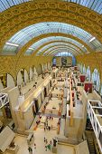 PARIS, FRANCE - SEPTEMBER 12, 2013: People in the Musee d'Orsay. Opened in 1986, the museum houses t
