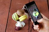 smartphone shot Italian almond macaroons with a cup of espresso