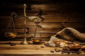 stock photo of coffee grounds  - Coffee theme with brass scales still - JPG