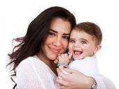 Closeup portrait of cute mother with daughter isolated on white background, young attractive woman hugging sweet adorable child, happy childhood concept